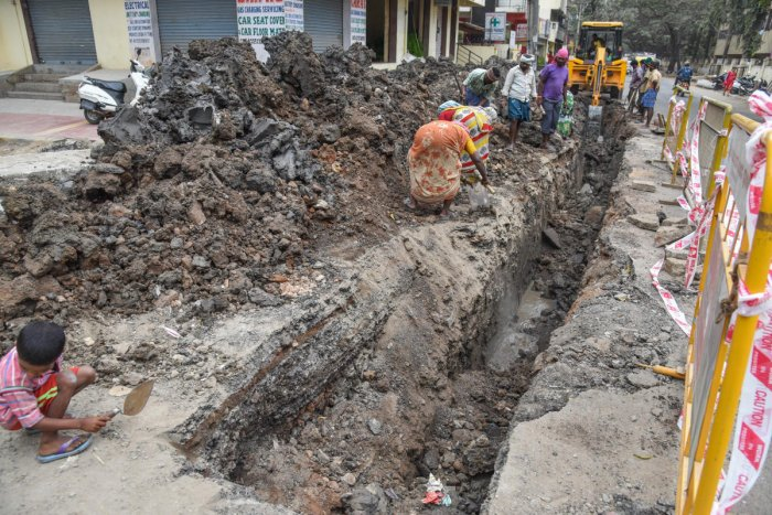 While the BWSSB is laying new sanitary pipelines along the BTS road in Hombegowda Nagar, the BBMP is to begin the white-topping project next week. DH PHOTO/S K Dinesh