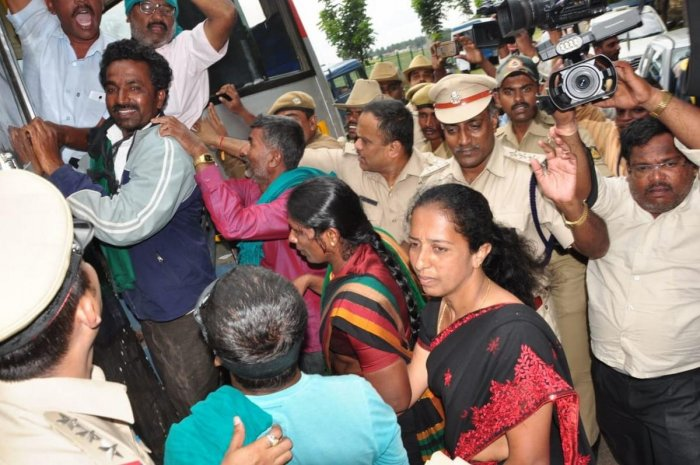 Farmers taken into custody for staging a protest against the Chief Minister H D Kumaraswamy at V C Farm, Mandya, on Friday.