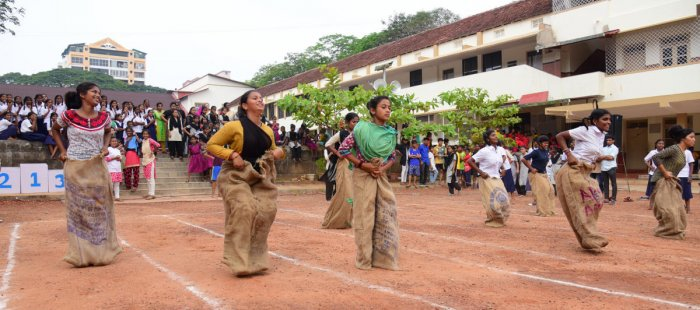 Children take part in a sack race at the Orphanage Olympics held at Canara High School Urva in Mangaluru.