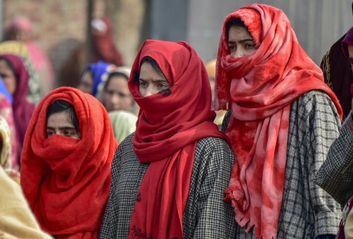 Family members and relatives mourn teh death of 16-year-old Numaan Ashraf who was killed in a clash near encounter site at Batagund area of Shopian districk of J&K, Sunday, Nov. 25, 2018. (PTI Photo)