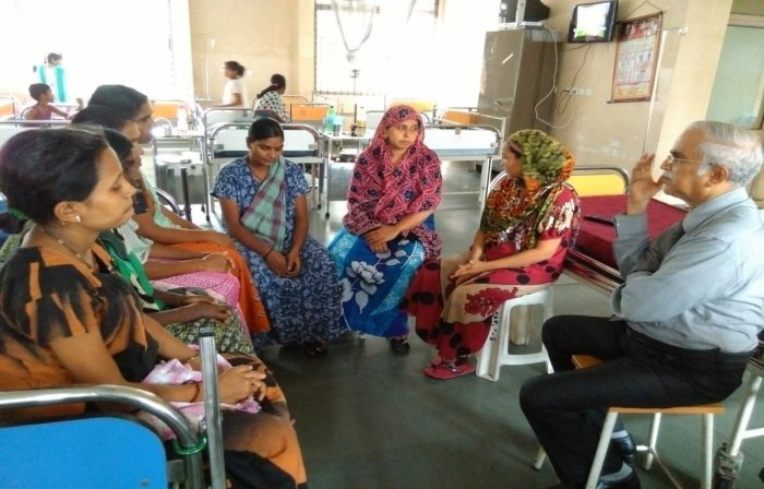 DK District Early Intervention Centre (DEIC) Nodal Officer Dr UVShenoy interacts with young mothers on nutritional aspects at Lady Goschen Hospital in Mangaluru.