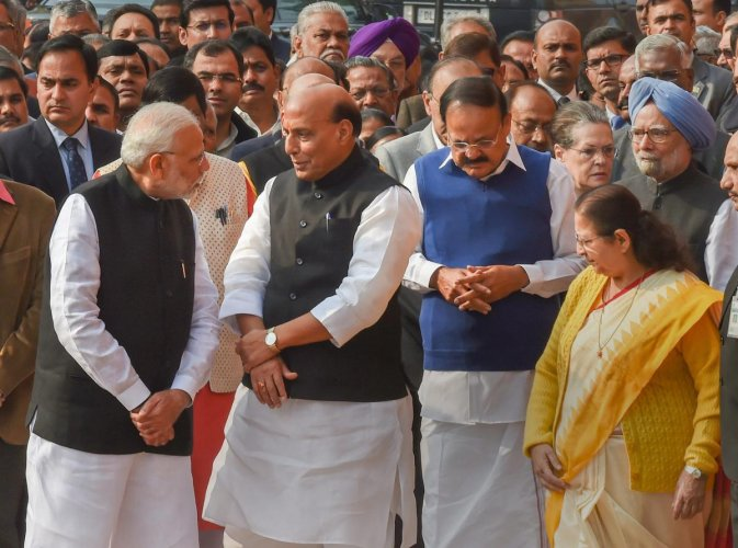 PM Modi, Home Minister Rajnath Singh, Vice President M Venkaiah Naidu, former PM Manmohan Singh, Lok Sabha Speaker Sumitra Mahajan and other dignitaries at a ceremony to pay tribute to the martyrs of 2001 Parliament attack on its 17th anniversary, at Parliament in New Delhi, Thursday. PTI Photo