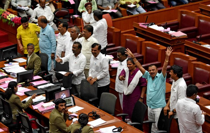 Opposition Leader in the Legislative Council Kota Srinivas Poojary and other BJP members trooped into the well of the House to register their protest for not allowing a discussion on the Tipu Jayanti issue during the winter session at the Suvarna V