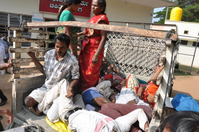 The people, who took ill after eating prasada at a temple at Selavadi in Hanur taluk,are being taken to Kollegala Taluk Hospital in a goods auto