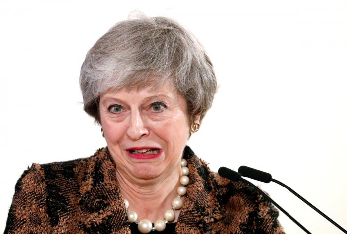 British Prime Minister Theresa May reacts as she attends a news conference after a European Union leaders summit in Brussels, Belgium December 14, 2018. REUTERS/Francois Lenoir