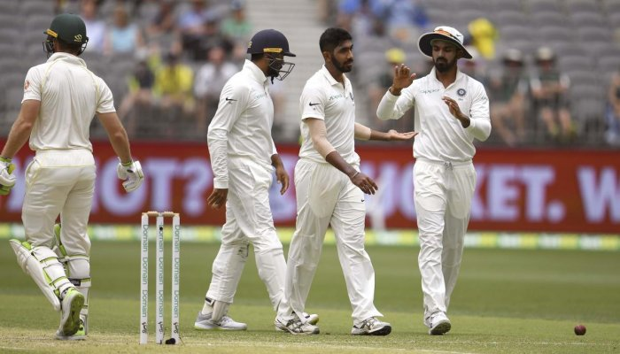 India's Jasprit Bumrah (2nd R) is congratulated by teammates after dismissing Australian batsman Tim Paine (L) during the second day of the second cricket Test match between Australia and India in Perth on December 15, 2018. (AFP Photo)