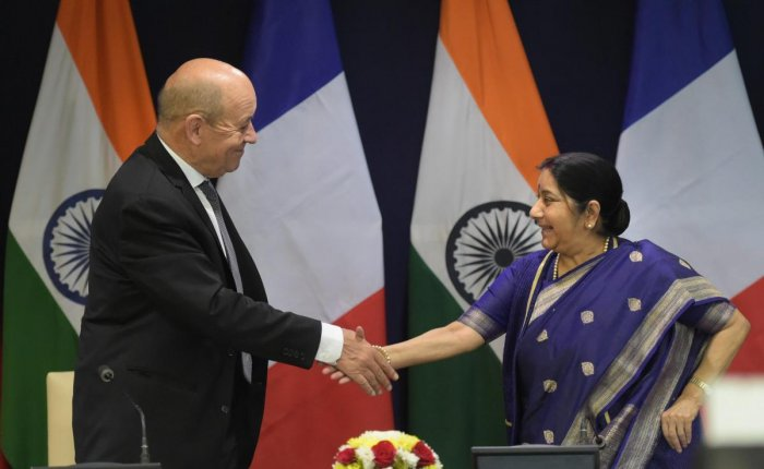 External Affairs Minister Sushma Swaraj and Minister of Europe and Foreign Affairs of France Jean-Yves Le Drian exchange greetings after their joint press statement in New Delhi on Saturday. PTI