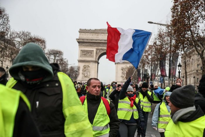 """President Emmanuel Macron, facing the biggest crisis of his presidency, announced a series of concessions on Monday to defuse the explosive """"yellow vest"""" movement which sprang up in rural and small-town France last month. (AFP Photo)"""