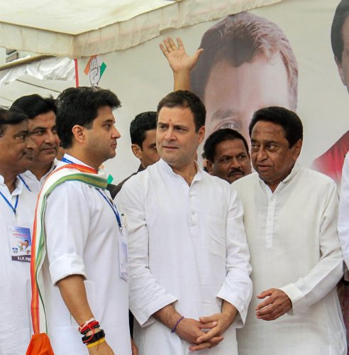 Congress President Rahul Gandhi (C), Congress leader and MP Jyotiraditya Madhavrao Scindia (L) and State President Kamal Nath during a roadshow, in Bhopal. (PTI File Photo)