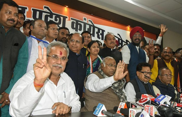 Senior Congress leader Mallikarjun Kharge, Chhattisgarh Chief Minister designate Bhupesh Baghel, Congress state in-charge P L Punia and others during a press conference after the Congress Legislature Party (CLP) meeting, in Raipur on Sunday. PTI photo