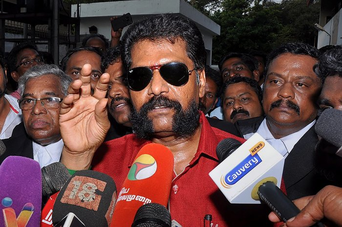 Senior journalist R Gopal, who heads the Tamil weekly magazine 'Nakkheeran', addresses the media as he is being taken to court in Chennai on Tuesday. PTI