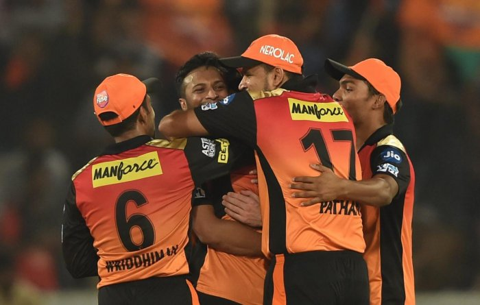 THRILLED: Sunrisers Hyderabad players celebrate after clinching a nervy five-run win over Royal Challengers Bangalore in Hyderabad on Monday. PTI