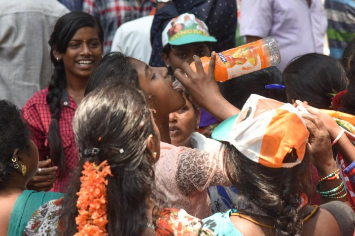 Drinking water supply in jeep for Followers came at congress candidate M Krishnappa filling nomination for Vijayanagar Assembly constituency election rally in Vijayanagar, Bengaluru on Monday. Photo by S K Dinesh