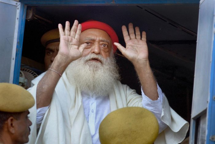 **FILE** New Delhi: File photo of Asaram Bapu after being produced at the sessions court in Jodhpur, November 30, 2013. A Jodhpur court on Wednesday awarded life imprisonment to self-styled godman Asaram for raping a minor girl at his ashram in Rajasthan