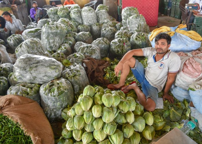 A vegetable vendor at Azadpur Mandi in New Delhi. The farmers' agitation entered the fifth day on Tuesday. PTI