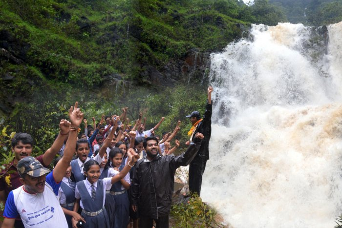 A group of students enjoys the beauty of Bangara Kusuma Falls near Gerusoppa in Honnavar taluk of Uttara Kannada district, which has come to life due to good rain in the region.