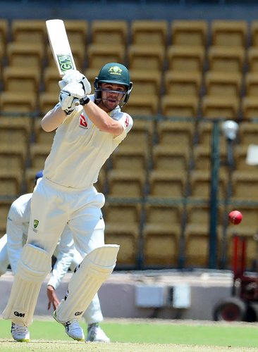 VALIANT: Travis Head of Australia 'A' en route his 87 against India 'A' during their four-day match. DH PHOTO/ SATISH BADIGER