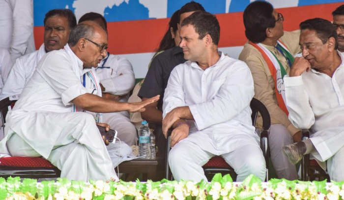Congress president Rahul Gandhi with senior leader Digvijay Singh and MPCC president Kamal Nath during a public meeting in Satna in Sept. PTI/FILE