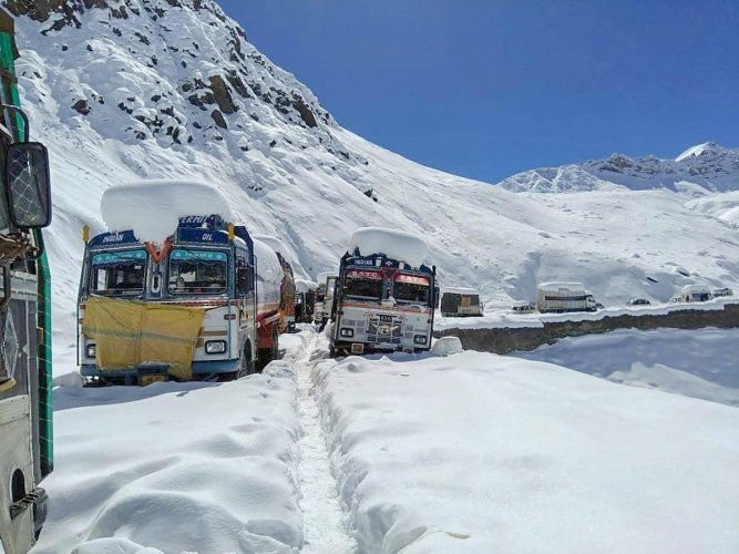 Manali: Wheels of vehicles carrying oil and food items for the army struck after snowfall, in Manali-Leh route, Manali, Friday, Sept 29, 2018. (PTI Photo) (PTI9_29_2018_000159B)