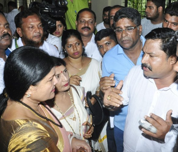 Congress workers gherao District In-charge Minister Jayamala in Udupi.