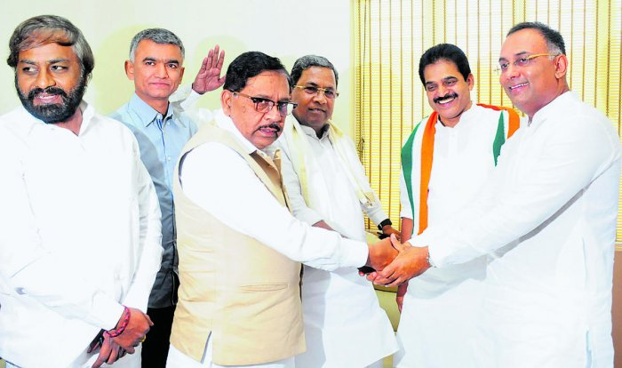 KPCC president Dinesh Gundu Rao greets Deputy Chief Minister G Parameshwara and former chief minister Siddaramaiah at the KPCC office in Bengaluru on Tuesday. (From left) KPCC working president Eshwar Khandre, Rural Development, Law and Parliamentary Affa