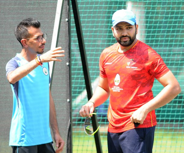 TALKING STRATEGIES: Mumbai's Rohit Sharma (right) and Haryana's Yuzvendra Chahal discuss a point during a practice session at the Chinnaswamy Stadium on Saturday. DH PHOTO/ SRIKANTA SHARMA R