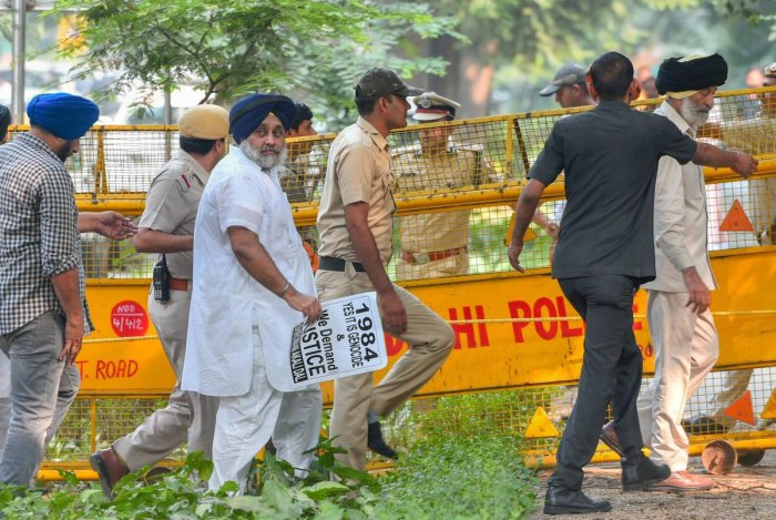 Police Shiromani Akali Dal leader Sukhbir Singh Badal and others who were staging a protest rally demanding justice for the families of those killed in the 1984 anti-Sikh riots, outside 10 Janpath in New Delhi on Saturday. PTI