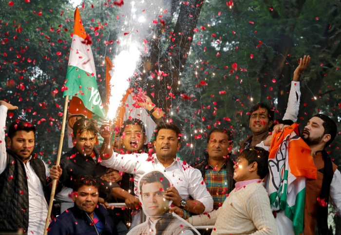 Supporters of India's main opposition Congress party celebrate after initial poll results at the party headquarters in New Delhi. REUTERS