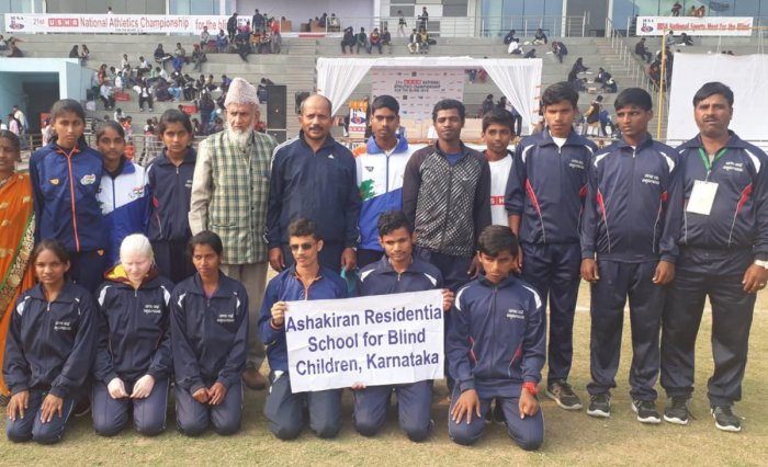 The students of Ashakiran Residential School for Blind Children with their coach.