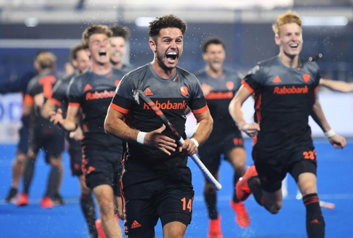 The Netherlands celebrate after their victory over Australia in a pulsating semifinal contest in Bhubaneswar on Saturday. AFP