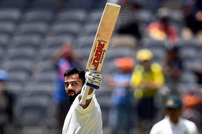 Virat Kohli celebrates after scoring his century against Australia on the third day of the second cricket Test match in Perth. AFP.