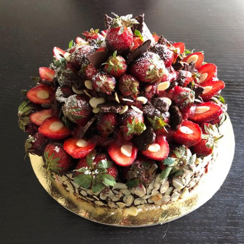 A chocolate, nuts and strawberry cake.