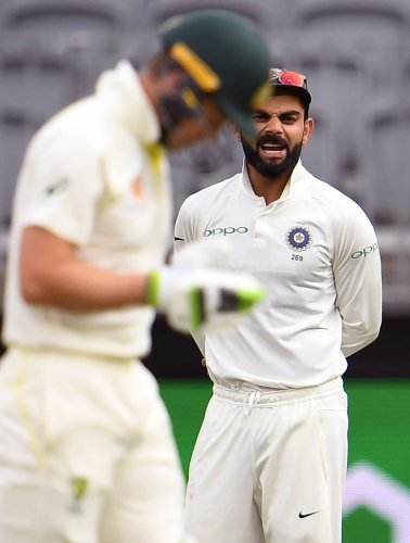Virat Kohli has some words to say to his Australian counterpart Tim Paine in Perth on Sunday. AFP