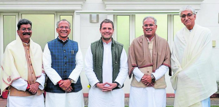 For throne and seats: Congress president Rahul Gandhi (C) with contenders for the post of chief minister of Chhattisgarh (From Left) Charandas Mahant, Tamradhwaj Sahu, Bhupesh Baghel and T S Singhdeo. Twitter/ @RahulGandhi
