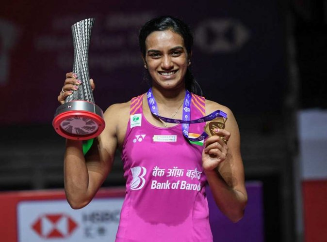 Winner PV Sindhu of India poses with her trophy after the women's singles final match at the 2018 BWF World Tour Finals badminton competition in Guangzhou in southern China. AFP Photo