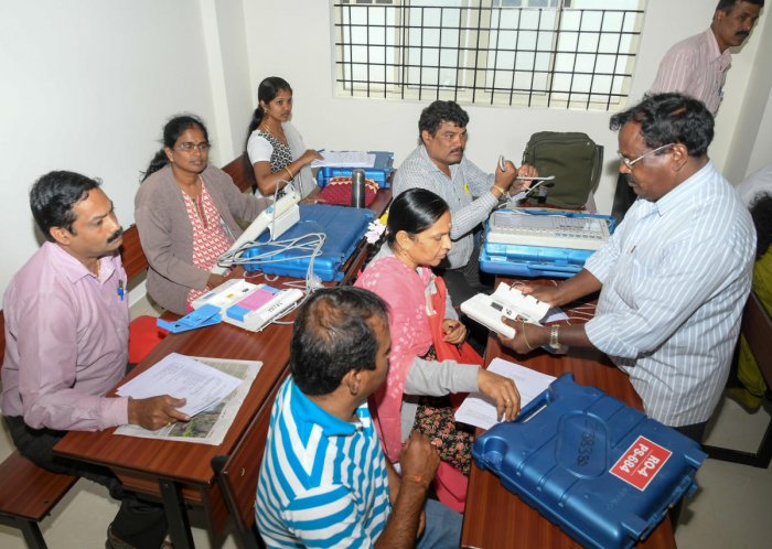Election officials prepare to conduct election for Urban Local Body, in Mysuru, on Thursday.