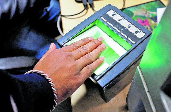 People giving their biometrics at an Aadhaar enrolment centre in Bengaluru.