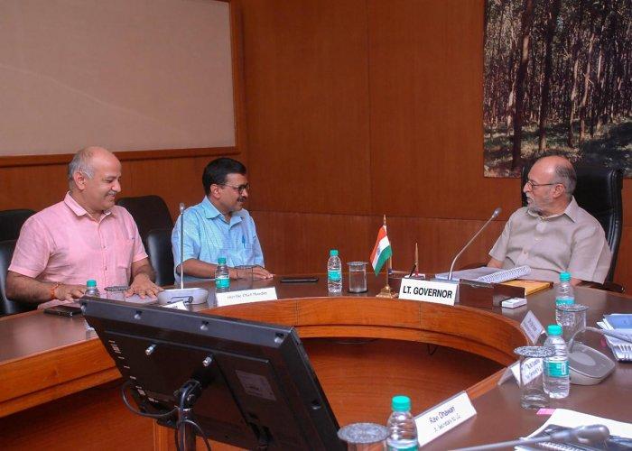 Delhi Chief Minister Arvind Kejriwal and his deputy Manish Sisodia (left) meet Lt Governor Anil Baijal (right), in New Delhi on Frida. PTI