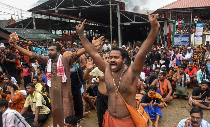 Sabarimala: Protesters oppose the entry of women to the Sabarimala Temple, Kerala, Friday, Oct 19, 2018. Rehana Fathima and journalist Kavitha Jakkal were taken escorted to the temple but the priest reportedly locked it and the women had to return mid-way