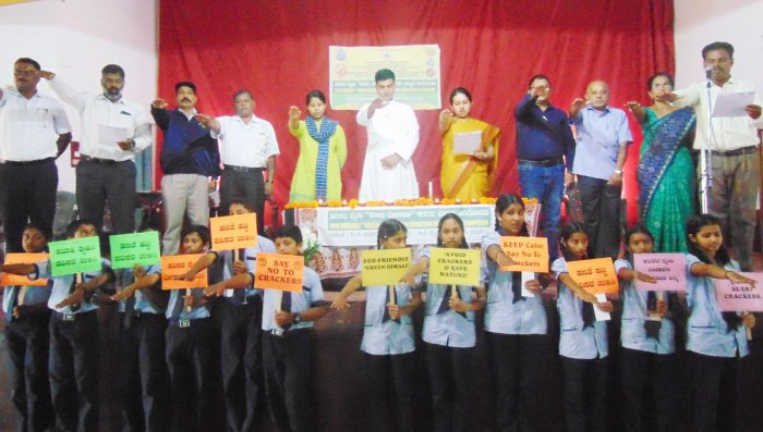 District officials, staff and students take a pledge to observe an eco-friendly green Deepavali, at St Michael High School in Madikeri on Saturday.