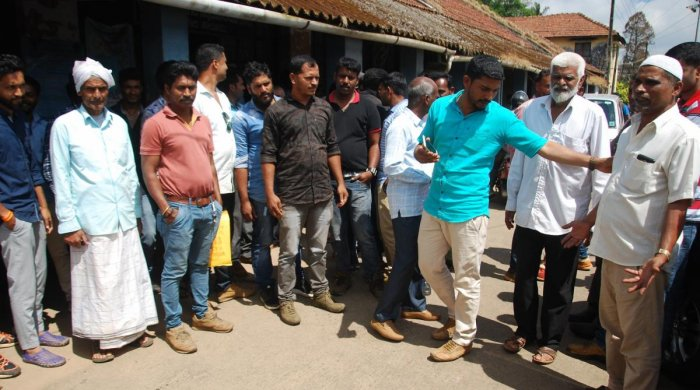Public stage a protest in front of Tahsildar's office for serving notices to innocents.