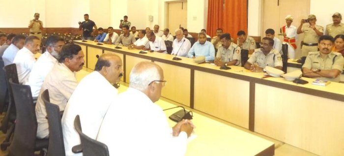 Officials take part in a preparatory meeting on Tipu Jayanti in Madikeri on Monday. DH photo