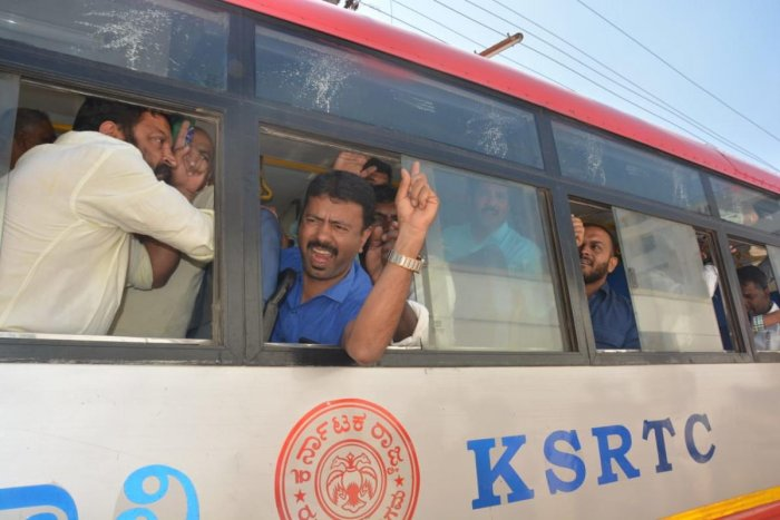 Police bundle BJP protesters into a bus in Chikkamagaluru on Friday.