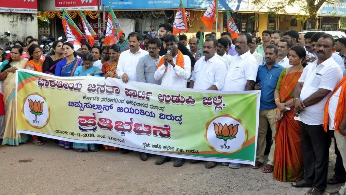 Leader of Opposition in the Legislative Council Kota Srinivas Poojary addresses protesters during BJP's protest against Tipu Jayanti in Udupi on Friday.