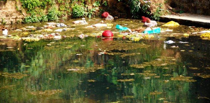 Trash dumped in Gowrikere near Omkareshwara temple in Madikeri.
