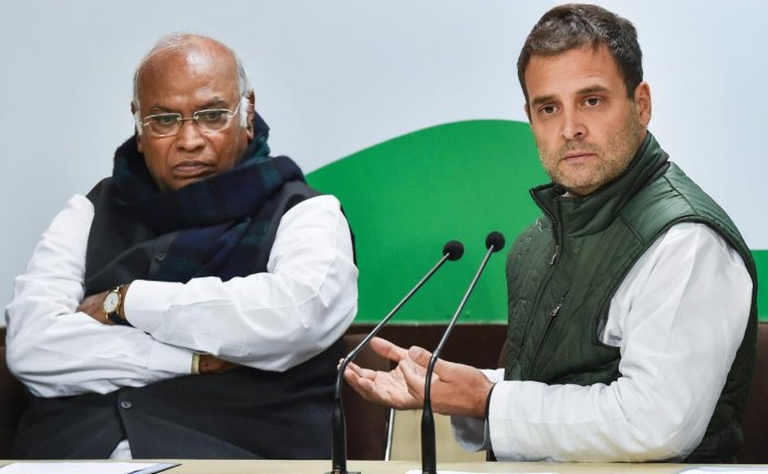 Congress president Rahul Gandhi with party leader Mallikarjun Kharge during a conference at AICC headquarters in New Delhi on Friday. PTI
