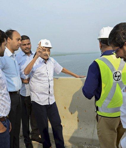 Goa Chief Minister Manohar Parrikar inspects the work of an under-construction bridge on Mandovi River, in Panaji on Sunday. PTI