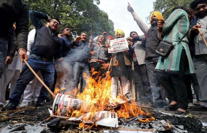 People burn placards and effigies of India's main opposition Congress party's leaders Sajjan Kumar and Kamal Nath during a protest near Congress party's headquarters in New Delhi, India, December 17, 2018. REUTERS