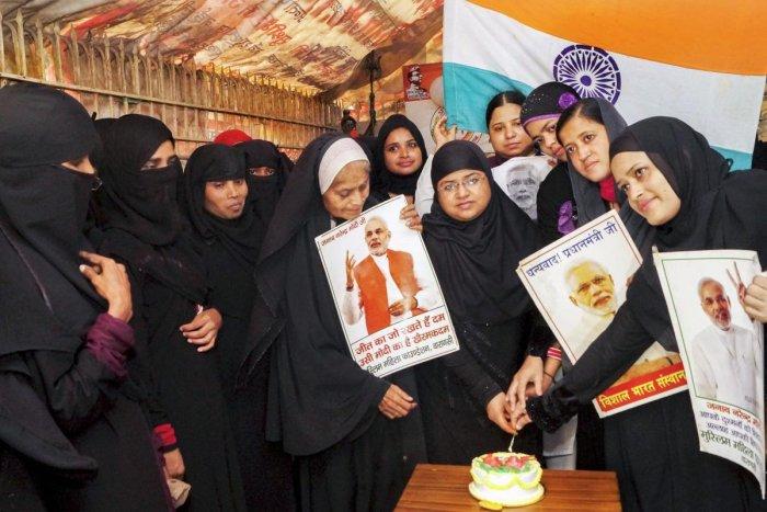Muslim women cut a cake ahead of Prime Minister Narendra Modi's birthday, in Varanasi. PTI Photo