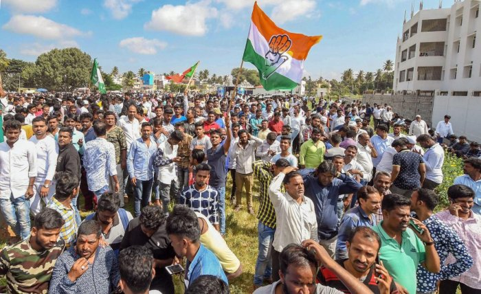Congress party workers celebrate their win in Karnataka Urban Local Body Election 2018, in Mysuru on Wednesday, Sept 3, 2018. (PTI Photo)